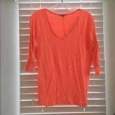 Neon Orange Shirt Neon orange v neck shirt. 3/4 length sleeve. Stitching down center of back detail. Looks great with patterned or white bottoms. GAP Tops Tees - Long Sleeve