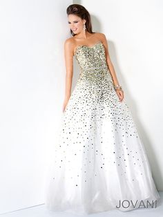 Sparkling princess sequin ball gown pageant gown Jovani 3068. Possess your pageant event as your fairy land, spreading magical twinkling snow flakes in every dance move you make. Tons of mirrored sequins take over this entire pageant masterpiece that features a strapless sweetheart neckline accented at the natural waist by a glamorous rhinestone belt. Find this ball gown in White/Gold. Wear a slip for extra volume and stiletto heels to give that princess final touch to this pageant gown.