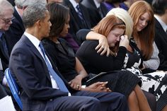 GRIEVING: President Barack Obama and the first lady looked toward mourners at a ceremony Sunday in Washington for victims of the Sept. 16 Wa...