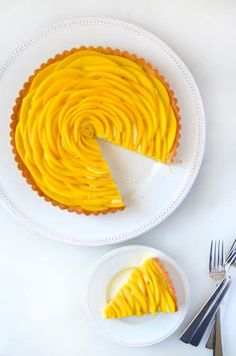 Add a pop of flavor and color to your dessert spread with the ultimate mango tart filled with vanilla pastry cream. Mango Recipes, Tart Recipes, Cream Recipes, Sweet Recipes, Cooking Recipes, Mango Dessert Recipes, Sweet Pie, Sweet Tarts, Vanilla Pastry Cream Recipe