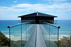 The Pole House hangs suspended over the six kilometres of white sand and rolling waves at ...