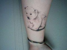 Cute little baby polar bear tattoo