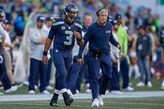 Russell Wilson Photos Photos - Quarterback Russell Wilson #3 of the Seattle Seahawks looks on from the sidelines after coming out of the game in the third quarter against the San Francisco 49ers at CenturyLink Field on September 25, 2016 in Seattle, Washington. Head coach Pete Carroll is at right. - San Francisco 49ers v Seattle Seahawks