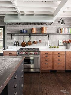 Like the variety of textures in this classic kitchen- brick wall and wood counter