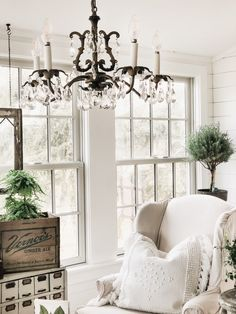 A Crystal Garden Chandelier In The Sunroom