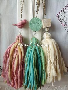 Resultado de imagen para sujeta cortinas borlas What great tassel,, made from wool roving and lumpy thick yarns. I love that clay bird bead a lot,too ^. Diy Tassel, Tassel Jewelry, Fabric Jewelry, Tassels, Jewellery, Diy And Crafts, Creative Crafts, Arts And Crafts, Diy Laine