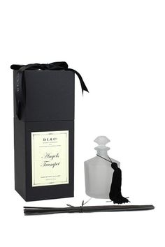 "Angel's Trumpet 10 Sided Diffuser by D.L. & Co.  Use it yourself or present it as a gift, this diffuser is tasteful, elegant and pleasant. - Color: white - Set of 10 - Fragrance notes: lemon blossom, angel's trumpet, exotic jasmine, indian tuberose, woodland mushrooms, tahitian vanilla - Use time: 6 months - Box package with ribbon - 6"" H x 3"" W x 3"" L - Imported Materials Oil, glass, wood $65.00"