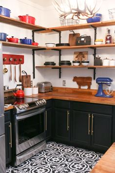 A ranch kitchen gets a rustic upgrade with butcher block cabinets, floating shelves, and graphic floor tiles. Click to watch Monica work her magic in this episode of The Weekender.