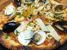 The Flying Goat Celebrate Valentine's Day weekend with the Aphrodisiac Pizza! Clams, mussels, shrimp and calamari with roasted tomato sauce, our house cheese blend topped with fresh basil and shaved parmesan! Then end the evening with our Chocolate-Framboise Budino Italian Pudding!