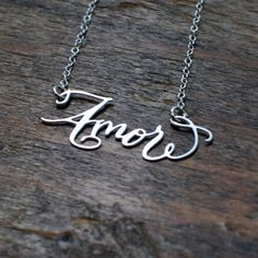 What's more romantic than the French language? If you're lucky in love, the Amore Necklace from Brevity is a charming way to say je t'aime. The calligraphy pendant is handmade from stainless steel and hangs at the nape of the neck on a 15-inch sterling silver chain.
