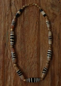 A necklace of chong dzi/chung dzi. Dzi are ancient agate beads believed by Tibetans and Chinese to have spiritual powers.