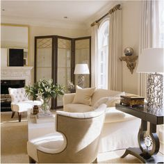 I like the balance of light colours - whites, creams, beiges etc.  With some wood.