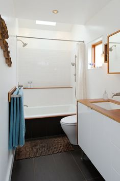 white & wood bathroom.