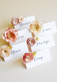 Custom colour luxury paper flower place cards.  These luxurious paper flower name cards add a beautiful romantic touch to your table decor. The