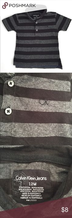 Calvin Klein boys striped T-shirt 12 mths Calvin Klein boys polo shirt. Black striped polo T-shirt with button down collar, size 12 months, excellent condition from pet free, smoke free home Calvin Klein Shirts & Tops Tees - Short Sleeve