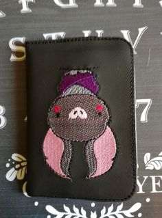 A pocket/ handbag sized notebook in an embroidered cover!