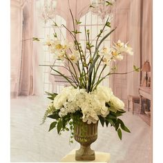 White Hydrangeas and Silk Orchids in Urn Brighten your home with this lovely silk flower design. Mini White hydrangea and ranunculus blossoms are arranged with small cymbidium orchids, wispy branches, fern, grasses in a heavy urn. Hortensien Arrangements, Church Flower Arrangements, Silk Floral Arrangements, Church Flowers, Beautiful Flower Arrangements, Beautiful Flowers, Hydrangea Care, Hydrangea Flower, Silk Hydrangea