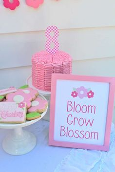 Pretty pink cookies and cake at a garden birthday party! See more party planning ideas at CatchMyParty.com!