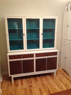 """Finished """"mid-century modern"""" buffet/china cabinet. Done with chalk paint and wax."""