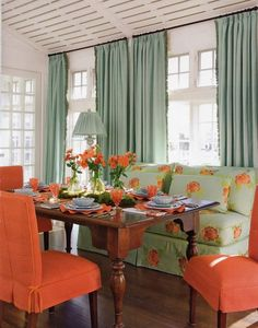 Mint and orange dining room; so clean and fresh!