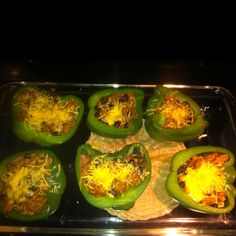 Taco stuffed green bell peppers. Start by boiling pepper halves for 5 mins. In the mean time cook beef or turkey with a small chopped onion. Drain meat, add black beans, taco seasoning with little water an taco sauce. I added to what looked good to the eye. Put peppers (boiled) in a 13x9. I lined peppers with some refried beans. You could add kidney beans to mixture instead. Add meat mixture to peppers. Top with shredded cheese. Bake for 10 mins on 350. Take out and top with tomato, lettuce…
