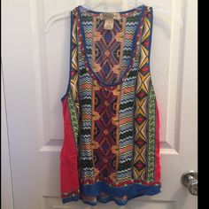 SALE! Tribal Festival Flying Tomato Racerback 100% rayon. EUC. Sz medium but doesn't have much extra room in the chest bc it has no stretch. Flowy around the waist so it's stomach flattering and a good length. Great for summer festival wear! Feel free to make a reasonable offer. Not sure whats reasonable? Check out the chart at the top of my closet! ☺️ Flying Tomato Tops Tank Tops