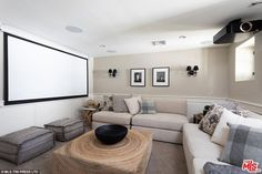 Film time: The space features a projector screen and enough seating to entertain friends. Home Theater Rooms, Home Theater Seating, Cinema Room, Naya Rivera, Small Home Theaters, Media Room Design, Chill Room, Living Spaces, Living Room
