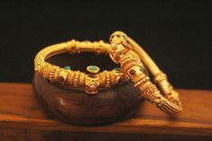 This is Manipuri traditional design of bangles. Traditional bangles are very Indian style it is totally folding bangle so its very easy to wear. It has a carving and an antique work . This is based on copper. Gold Bridal Jewellery Sets, Gold Wedding Jewelry, Gold Jewelry, Jewelery, Nose Ring Jewelry, Jewelry Design Earrings, Gold Earrings Designs, Gold Necklace Simple, Necklace Set