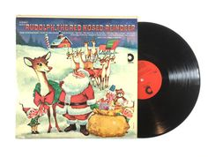 Santas Little Chorus & Orchestra – Rudolph, the Red Nosed Reindeer  Label: Design Records – SDLP-X-19 Format: Vinyl, LP, Album Released: 1989 Genre: Childrens, Folk, World, & Country Style: Holiday  Tracklist:  A1 Rudolph, the Red Nosed Reindeer A2 Up on the Housetop A3 Deck the Halls A4 O Little Town of Bethlehem A5 Jingle Bells A6 Away in a Manger A7 Silent Night B1 We Wish You a Merry Christmas B2 Parade of the Wooden Soldiers B3 What Child is This B4 I Saw Three Ships B5 We Three Kings…
