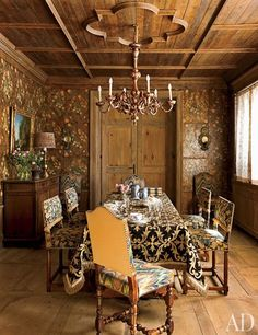 The dining room is sheathed in 19th-century painted leather | archdigest.com