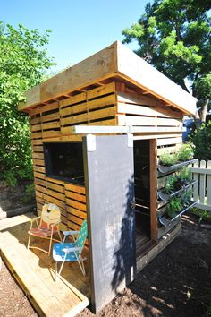 An Earth-Friendly Playhouse - It includes plants in the gutters and a chalkboard barn door. Pallet Playhouse, Build A Playhouse, Playhouse Outdoor, Outdoor Play, Outdoor Spaces, Outdoor Living, Outdoor Decor, Modern Playhouse, Pallet Patio