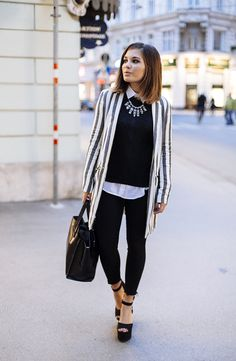 Fall outfit: striped coat, black sweater, white shirt, black skinny pants, exchange sandals with boots, black bag