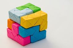 Sean @ MAKE points us to this nifty polycube puzzle folded out of paper by Qiao Chang.