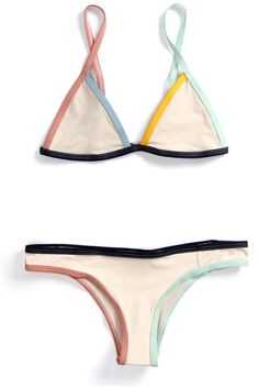 A Tavik swimwear favorite, the Jett is a fixed triangle top that features adjustable shoulder straps with metal sliders and is finished with a multicolored binding detail. It's made with a premium ble