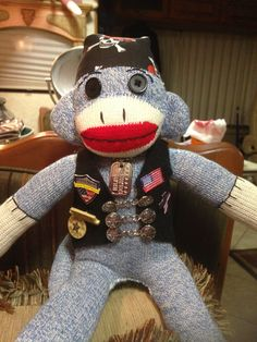 My husband, a Patriot Guard Rider, wanted a special companion to ride with. So here he is, made with love! This guy has military dog tags, vest extenders, skull & crossbones do-rag and other biker embellishments.