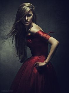 The tones in this are gorgeous, love the low key lighting and subtle red of her dress.