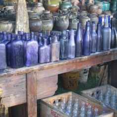 purple bottle collection.  I think this frosty look comes from being buried in hot sand for decades