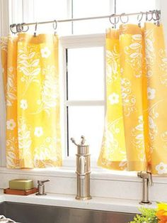 DIY Kitchen Curtains! Need a pair of these for our kitchen window that looks just like this above the sink. Easily sewn with some custom fabric and ring clips + a tension rod (no drilling into the window frame). Loving this sunny yellow.