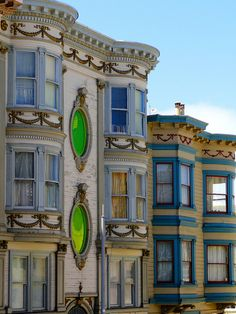 Exterior detail on some lovely painted ladies in San Francisco. Those green glass windows are awesome.