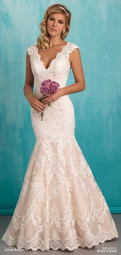 Classic lace composes this simple yet striking gown.