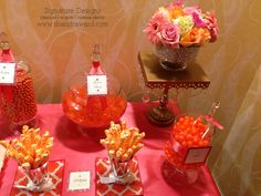 Coral & Gold candy buffet created by Signature Sweets by Signature Designs. www.signatureweetshouston.com  Floral design by Signature Designs