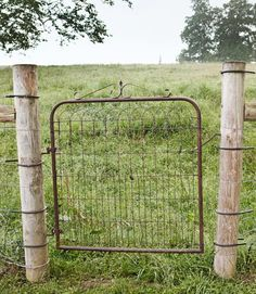 This 1940s gate provides plenty of visibility and seamlessly blends into the low-key garden landscape.