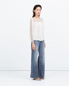 Immagine 1 di TOP BICOLORE GUIPURE di Zara