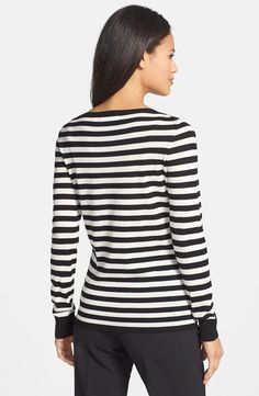 When Queen Letizia visited A Coruna, she combined a black skirt with a new knit top, a Hugo Boss black/white striped sweater (US$195). The fine-gauge sweater is crafted from pure wool and styled in a slim, hip-length silhouette.