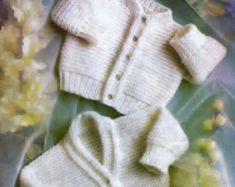 Knitting pattern for baby Jacket, Shawl, Weater and shorts  Uses 3 ply or 4 ply yarn  Premature baby sizes included - 12 ins to 18 ins chest No resale rights on here or any other website - in accordance with Etsys policies 3ply = Super fine Sock. Baby or fingering 4ply = Fine sports weight yarn  AGE CHEST/ Size Weight Premature 12/14 ins up to 4.5 lbs Birth 16/17 ins 7.5 lbs 3 months 18 ins 11.5 lbs 6 months 19 ins 16 lbs kc 31 14