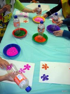 Bottle bottom flower prints.  Seen it before, but now think the kids would actually like it.