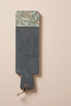 Anthropologie Paua Shell Cheese Board https://www.anthropologie.com/shop/paua-shell-cheese-board?cm_mmc=userselection-_-product-_-share-_-41537614