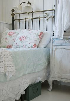Cozy shabby chic bedroom.  What's in the box under the bed?