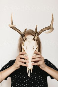 person holding deer skull in front of face with both hands by Nicole Mason - Vintage, Antler - Stocksy United Dystopia Rising, Deer Skulls, Skull Face, Face Photo, Antlers, Giraffe, Moose Art, The Unit, Stock Photos