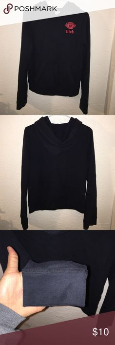 Abercrombie, thin black sweater with hood Thin, black hoodie with front pocket and NY Fitch label in red on left side. No damage. Worn for a few weeks inconsistently. Very Comfortable, just no longer my style. Abercrombie & Fitch Sweaters Cardigans